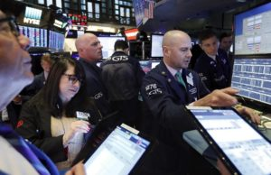 Stocks hit record highs, looking to extend Santa Claus rally