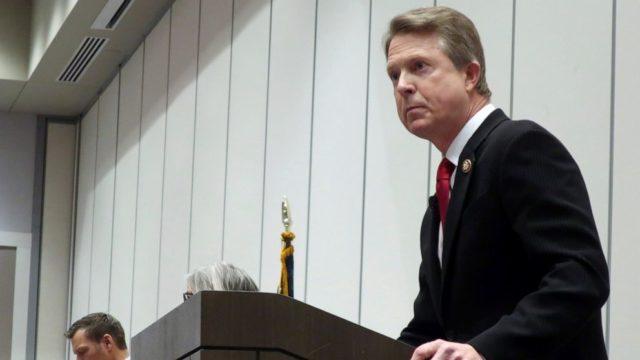 Kansas Senate rivals try to minimize Kobach's ties to Trump