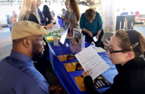 New U.S. jobless claims fall 15,000 to 202,000 and return close to a 50-year low