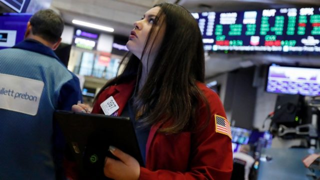 Global stocks mixed after Wall Street rises to record