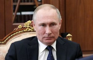 Putin approves law that could keep him in power until 2036