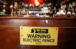 Pub adds electric fence to remind customers of social distancing