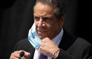 Cuomo takes over governors group as virus batters states
