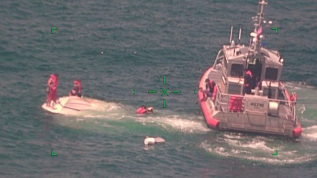 Family of 4 rescued, found clinging to overturned boat