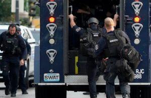 Gunman who shot 2 officers arrested after 12-hour standoff