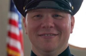 Body of slain detective gets hero's escort to funeral home
