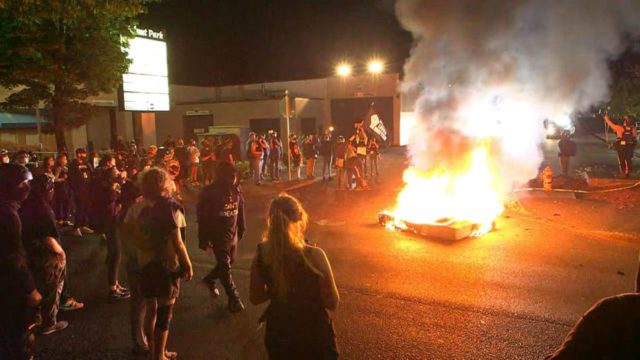 Clashes in Portland erupt again, police make 11 arrests